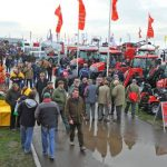 Large groups of visitors at the LAMMA agricultural exhibition showing the various outdoor stands and machinery